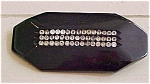 Black bakelite pin with rhinestones