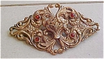 Art nouveau sash pin with topaz rhinestones