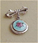 Sterling bow pin with enameled rose