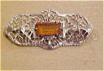 Filligree pin with topaz rhinestone