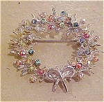 Wreath pin with rhinestones