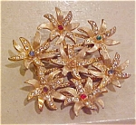 Floral pin with rhinestones