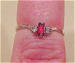 Ring with red and clear rhinestones