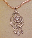 Art deco pendant on faux pearl necklace