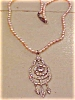 Click to view larger image of Art deco pendant on faux pearl necklace (Image2)