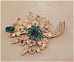 Czechoslovakian pin with green rhinestones