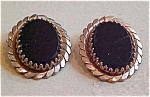 Brass and black glass earrings