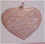 Heart charm that says I Love You