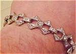 Pot metal and rhinestone bracelet