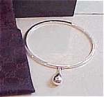 GUCCI sterling silver bangle with drop
