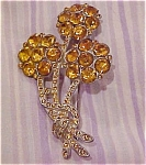 Flower pin with topaz rhinestones