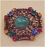Goldtone pin with cab and rhinestones