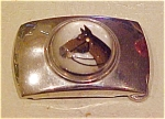 Click here to enlarge image and see more about item x1990: Belt buckle with horse under lucite