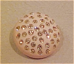 Plastic button with citrine rhinestones