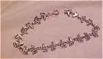 Sterling bracelet with feet