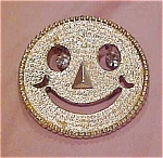 Smiley face pin with rhinestone eyes