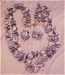 Click here to enlarge image and see more about item x2426: Blue shell necklace and earring set