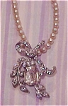 Click here to enlarge image and see more about item x2544: Faux pearl and rhinestone necklace