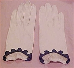 white leather gloves with navy trim