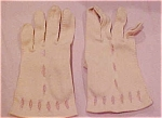 Pink/peach gloves with cutouts