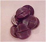 7 brown plastic buttons