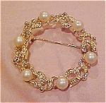 Circle pin w/rhinestones & faux pearls