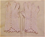 beige crocheted gloves