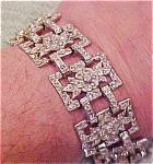 Click here to enlarge image and see more about item x2952: Rhinestone bracelet with flower design
