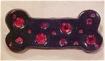 Dog bone pin with red rhinestones