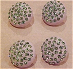 4 rubber and green rhinestone buttons