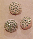 3 rubber buttons with green rhinestones