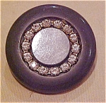 Plastic grey button with rhinestones