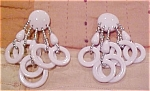 White funky plastic earrings