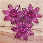 Purple plastic dress clip with rhinestones
