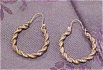 Click here to enlarge image and see more about item x3412: 14k gold hoop earrings