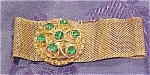 Goldtone bracelet with green rhinestones