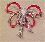 Red enamel bow pin
