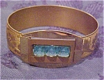 Engraved bangle with blue stones