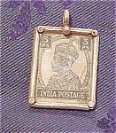 Pendant with India stamp in it