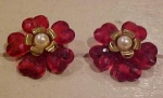 2 red plastic flower pins