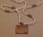 Freshwater pearl necklace w/calendar charm