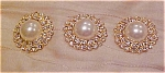 Click here to enlarge image and see more about item x5190: 3 faux pearl and rhinestone buttons
