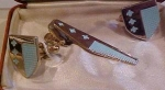 Anson enameled tie bar and cufflinks