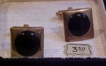 Cufflinks with black stone in box