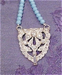Art deco pendant on beads