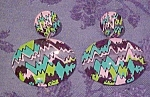 Contemporary plastic earrings