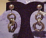 Silvertone loop design earrings