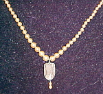 Faux pearl necklace with pendant
