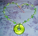 Click here to enlarge image and see more about item x5927: Contemporary necklace with green glass