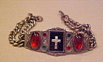Click here to enlarge image and see more about item x5994a: Religious bracelet with cross
